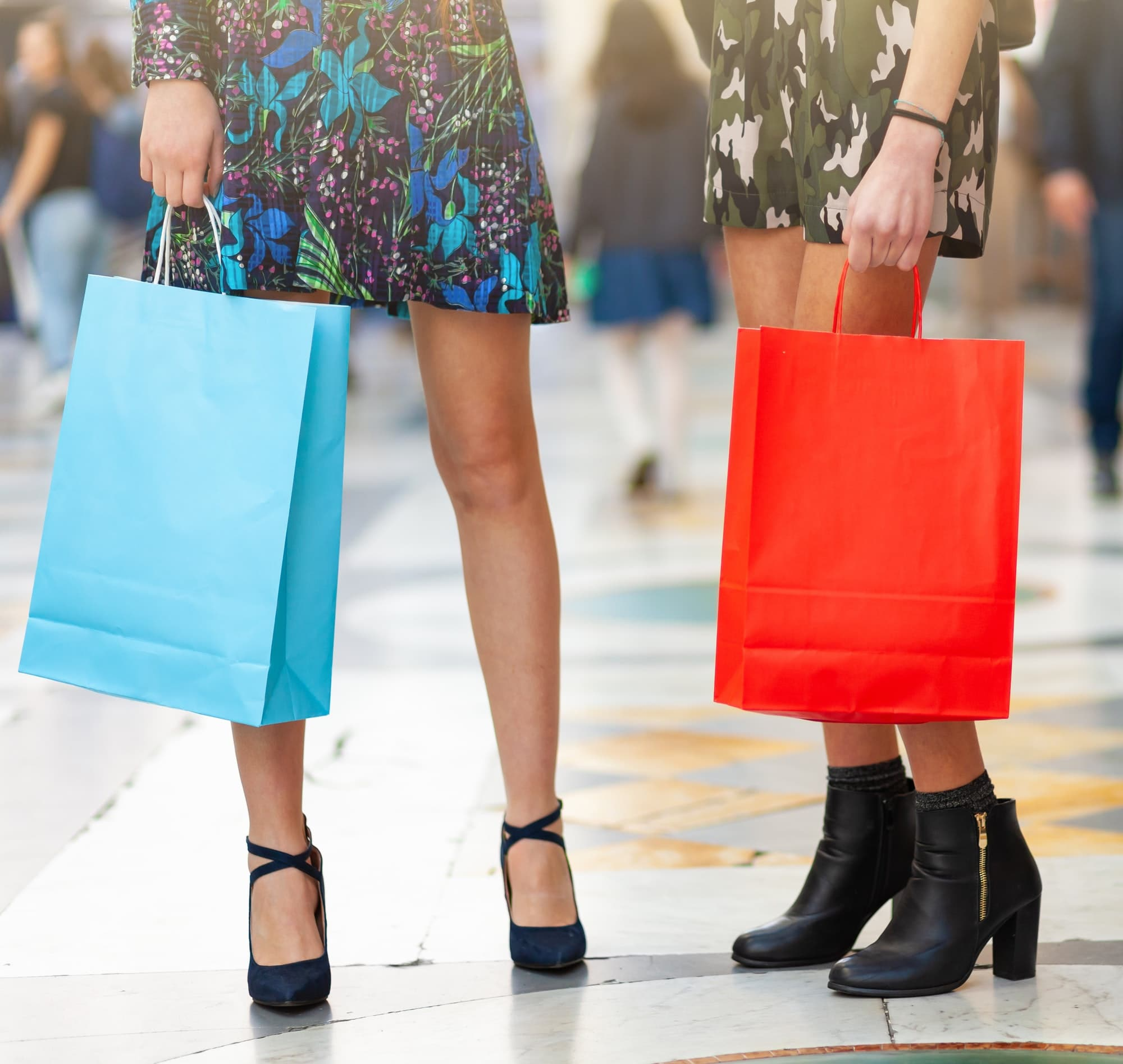 Closeup of legs and shopping bags.